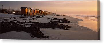 Changing Room Huts On The Beach Canvas Print by Panoramic Images
