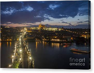 Charles Bridge And Prague Castle After Thunderstorm At Night Canvas Print by Bart De Rijk