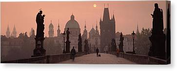 Charles Bridge At Dusk With The Church Canvas Print by Panoramic Images