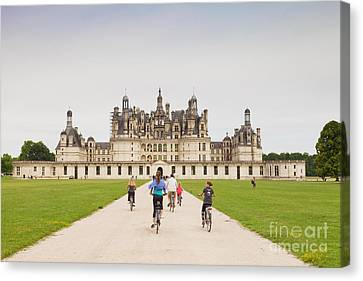 Chateau Chambord And Cyclists Canvas Print by Colin and Linda McKie