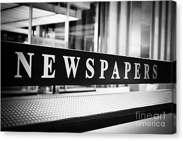 Chicago Newspapers Stand Sign In Black And White Canvas Print by Paul Velgos