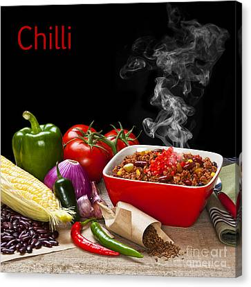 Chilli And Ingredients With Steam Rising Canvas Print by Colin and Linda McKie