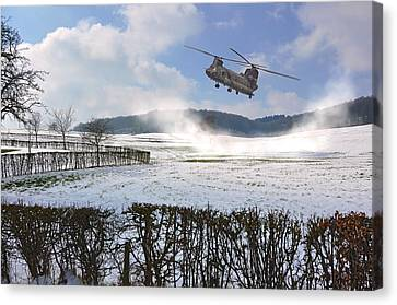 Chinook In Snow Dust Canvas Print by Nop Briex