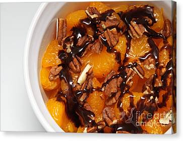 Chocolate Drizzled Mandarin Oranges With Nuts  Canvas Print by Andee Design