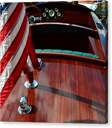 Chris Craft With Flag And Steering Wheel Canvas Print by Michelle Calkins