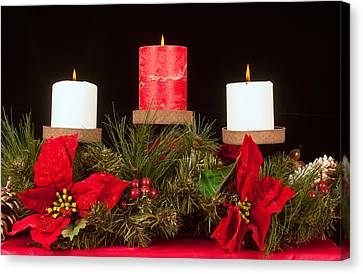 Christmas Candle Trio Canvas Print by Kenneth Sponsler