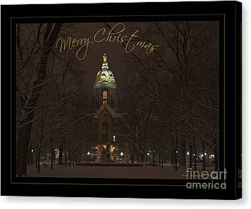 Christmas Greeting Card Notre Dame Golden Dome In Night Sky And Snow Canvas Print by John Stephens
