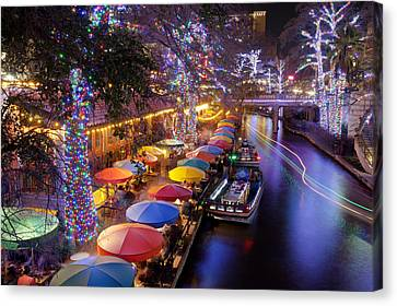 Christmas On The Riverwalk Canvas Print by Paul Huchton