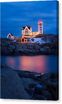 Christmas Time At Nubble Light. Canvas Print by Jeff Sinon