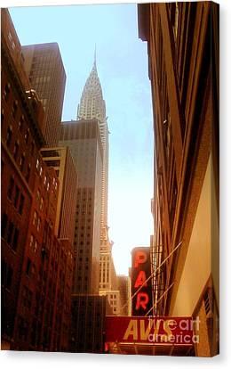 Chrysler Building Rises Above New York City Canyons Canvas Print by Miriam Danar
