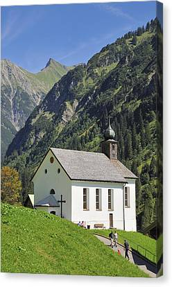Church In Kleinwalsertal Valley Austria Canvas Print by Matthias Hauser