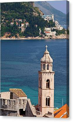 Church Tower Stands High Above The Old Canvas Print by Brian Jannsen