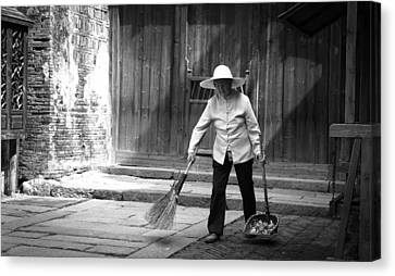 Cleaning Up Canvas Print by Becky Kozlen
