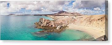 Cliffs On The Beach, Papagayo Beach Canvas Print by Panoramic Images
