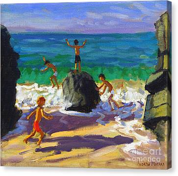 Climbing Rocks Porthmeor Beach St Ives Canvas Print by Andrew Macara