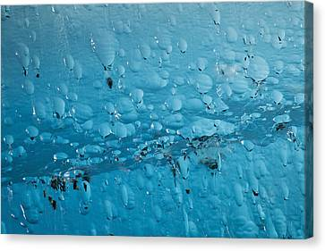 Close Up Of Air Bubbles In Iceberg Canvas Print by Ray Bulson