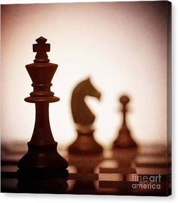 Close Up Of King Chess Piece Canvas Print by Amanda Elwell