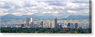 Clouds Over Skyline And Mountains Canvas Print by Panoramic Images