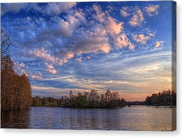 Clouds Over The River Canvas Print by Marvin Spates