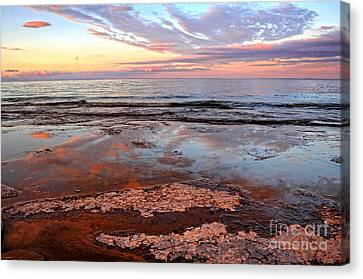 Clouds Reflections On Rock Beach Canvas Print by Charline Xia