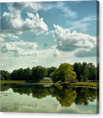 Cloudy Reflections Canvas Print by Kim Hojnacki