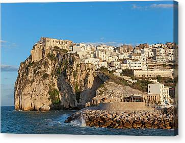 Coastal Village Of Peschici Canvas Print by Peter Adams