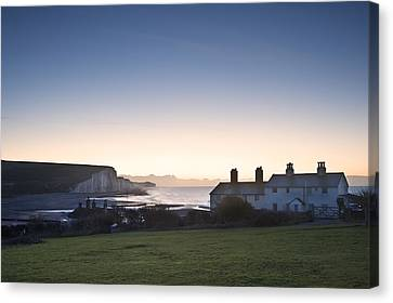 Coastgard Cottages At Seaford With Seven Sisters In Background Canvas Print by Matthew Gibson