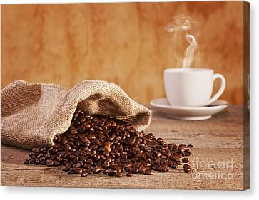 Coffee Beans And Burlap Sack Canvas Print by Colin and Linda McKie