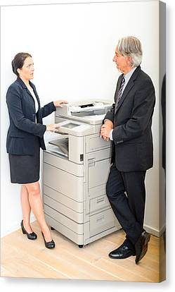Colleagues Talking At  Copying Machine In The Office Canvas Print by Frank Gaertner