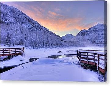 Colorful Sunrise Over A Stream Canvas Print by Lucas Payne