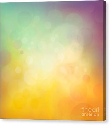 Colorful Yellow Bokeh Background Canvas Print by Mythja  Photography