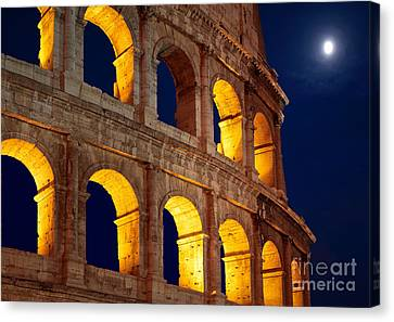 Colosseum And Moon Canvas Print by Inge Johnsson