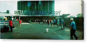 Commuters In Front Of A Ferry Terminal Canvas Print by Panoramic Images