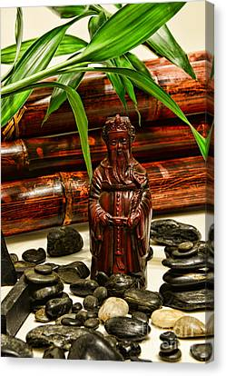 Confucius In The Garden Canvas Print by Paul Ward