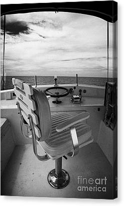 Controls On The Flybridge Deck Of A Charter Fishing Boat In The Gulf Of Mexico Canvas Print by Joe Fox