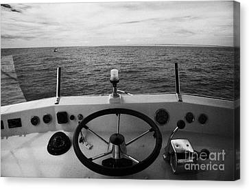 Controls On The Flybridge Deck Of A Charter Fishing Boat In The Gulf Of Mexico Out Canvas Print by Joe Fox