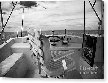 Controls On The Flybridge Deck Of A Charter Fishing Boat In The Gulf Of Mexico Out Of Key West Canvas Print by Joe Fox