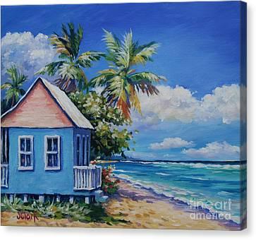 Cottage On The Beach Canvas Print by John Clark