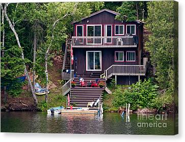 Cottage On The Water Canvas Print by Les Palenik
