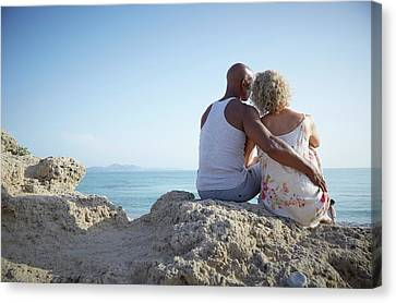 Couple Sitting On A Rock Canvas Print by Ruth Jenkinson