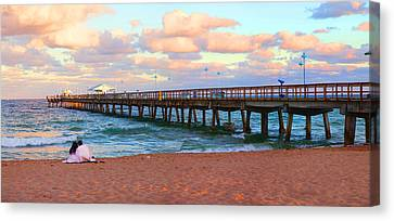 Couple Sitting On The Beach At Sunset Canvas Print by Panoramic Images