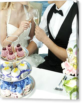 Couple Toasting At Wedding Canvas Print by Jacek Malipan