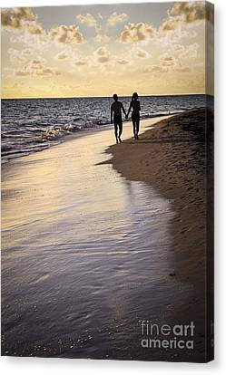 Couple Walking On A Beach Canvas Print by Elena Elisseeva