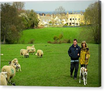 Couple With Dog On Cotswold Way Trail Through Green Pastures Near Broadway Village England Canvas Print by Robert Ford