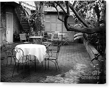 Courtyard Seating Canvas Print by John Rizzuto