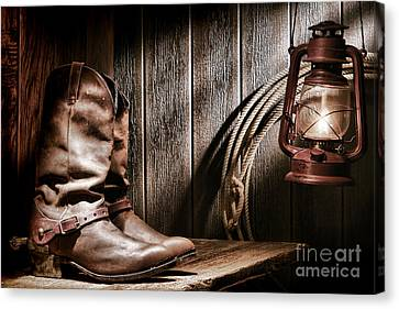 Cowboy Boots In Old Barn Canvas Print by Olivier Le Queinec