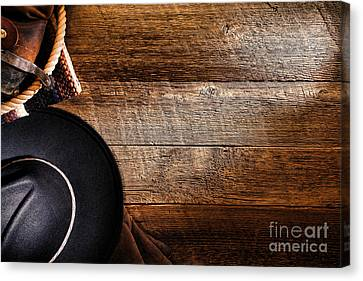 Cowboy Gear On Wood Canvas Print by Olivier Le Queinec