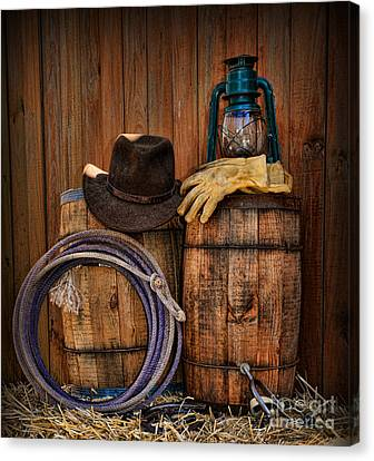 Cowboy Hat And Bronco Riding Gloves Canvas Print by Paul Ward