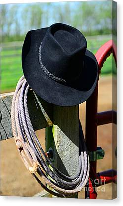 Cowboy Hat On Fence Canvas Print by Paul Ward