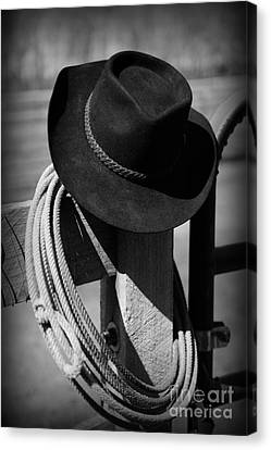 Cowboy Hat On Fence Post In Black And White Canvas Print by Paul Ward